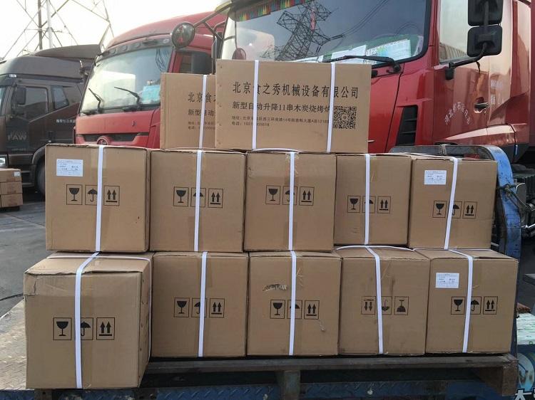 串越时光为吉林通化客户定做的28台木炭自动升降烧烤炉装车发货中